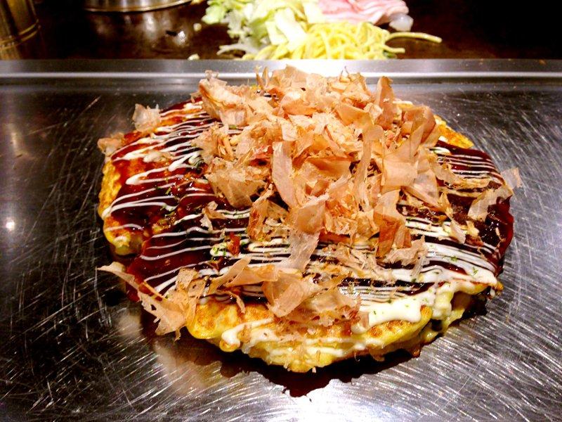 Osaka-style okonomiyaki on the griddle