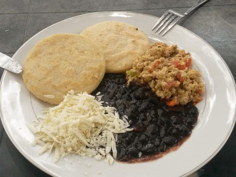 Venezuelan breakfast with perico scrambled eggs