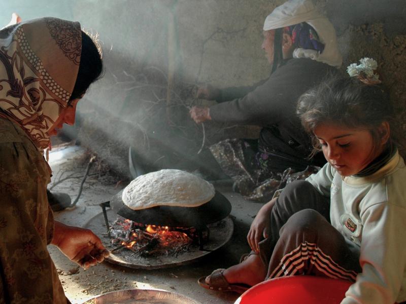 Palestinian women baking bread