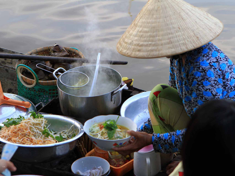 Vietnamese food vendor in a boat