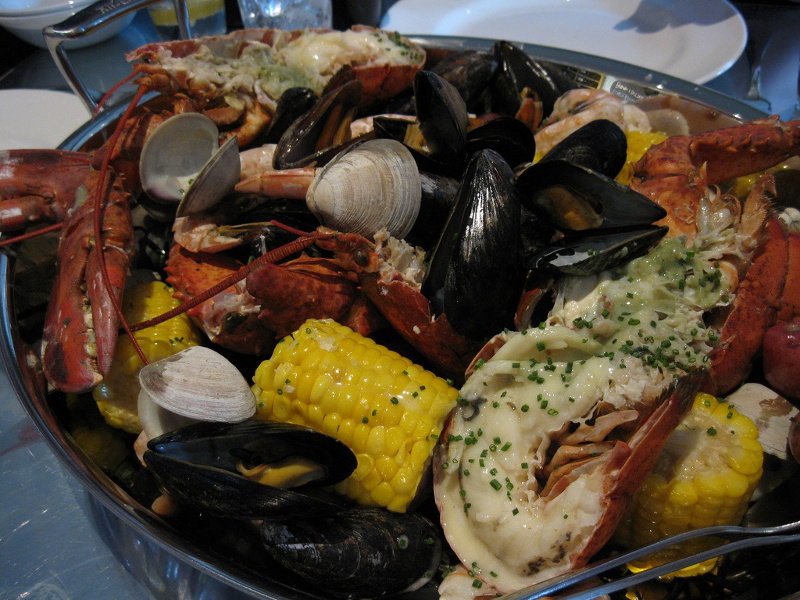 Clambake (American New England seafood and vegetable beach barbecue)