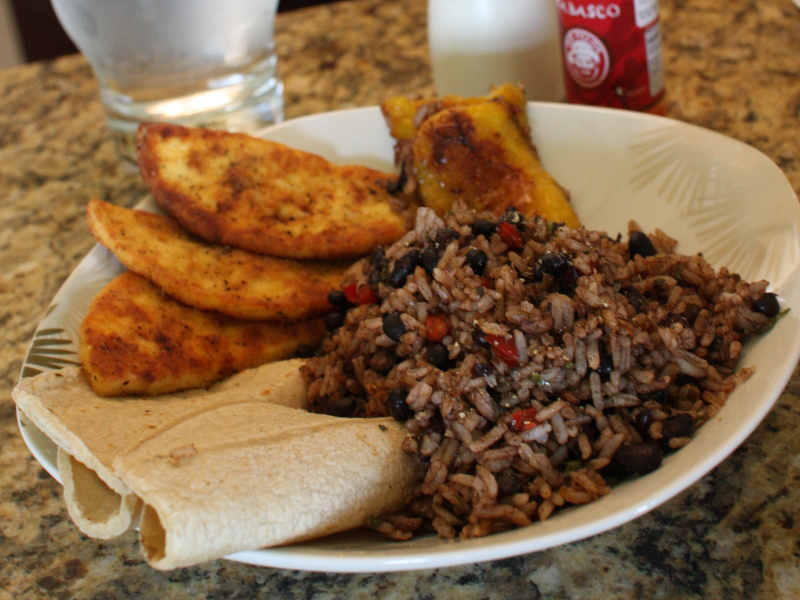 Breakfast of gallo pinto (casamiento) and fried plantains