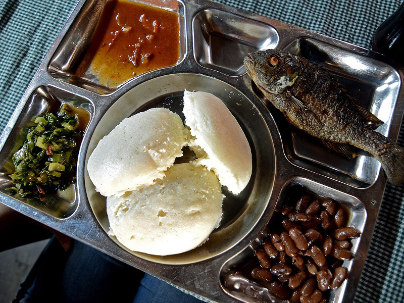 Tray of food with nsima, or nshima, cornmeal mush