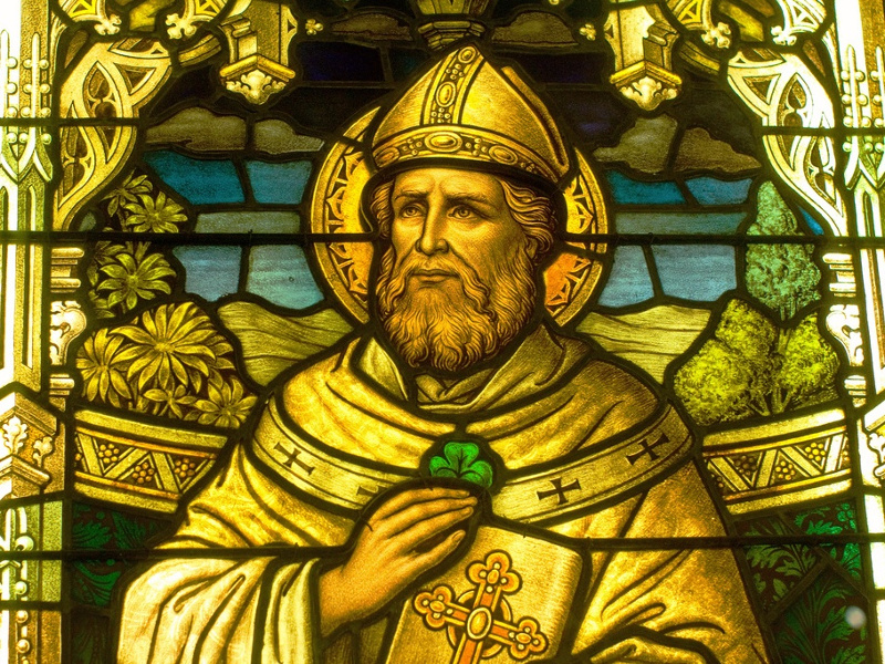 Stained glass of St. Patrick with a shamrock
