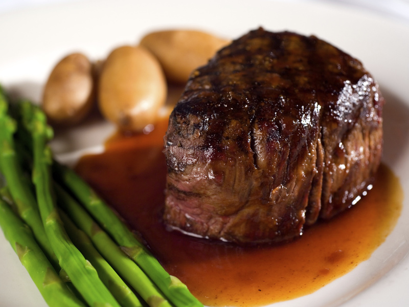 Carpetbag steak with asparagus and potatoes