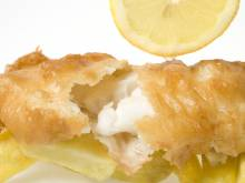 Crispy fried fish with fries and a squeeze of lemon