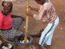 Women making fufu