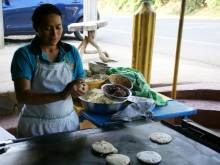 Woman making pupusas