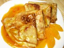 Crepes Suzettes (French thin pancakes with orange sauce)