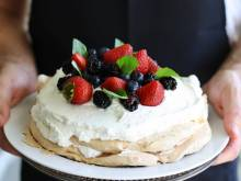 Pavlova (Australian meringue with whipped cream and fruit)