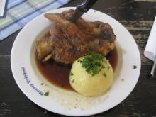 German potato dumpling with roast pork shank