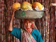 Woman carrying papaya