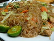 Pancit Bihon (Filipino stir-fried rice noodles with meat and vegetables)