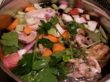 A pot of aromatics for chicken stock