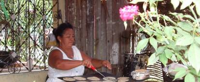 Honduran woman making tortillas