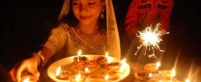 Children lighting Diwali lamps
