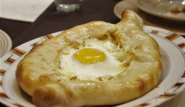 A loaf of Acharuli khachapuri, Georgian cheese bread