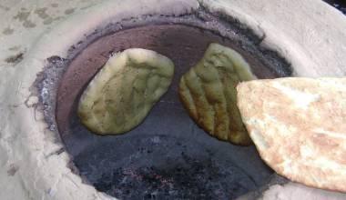 Naan bread in a tandoor oven