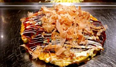 Osaka-style okonomiyaki on the griddle