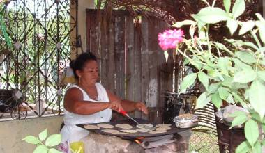 Honduran woman making tortillas