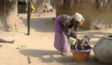 Senegalese mother bathing children