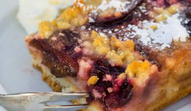 A piece of German blitzkuchen coffeecake with plums