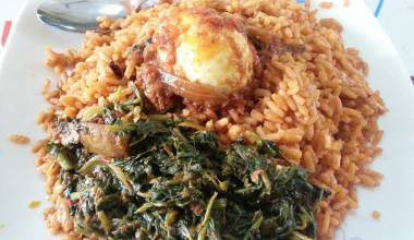Jollof rice with greens and a hard-boiled egg