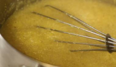 Whisking cornmeal mush