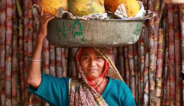 Woman carrying papaya