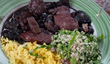 Plate with Brazilian feijoada completa