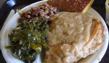 Plate with smothered pork chops