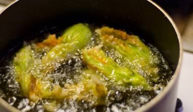 Deep frying squash blossoms