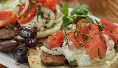 Plate of Greek gyros sandwiches