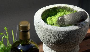 A mortar and pestle with handmade pesto