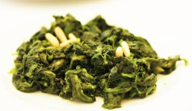 Spinach sauteed with pine nuts