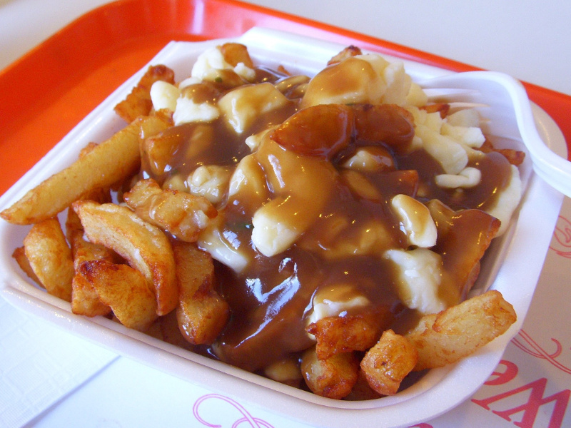 Poutine (Canadian fried potatoes with gravy and cheese curds)